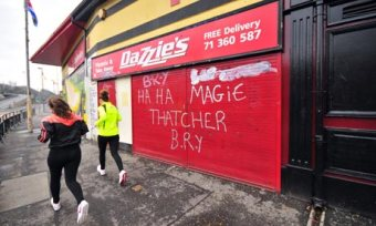 Margaret Thatcher protest sprayed on to a shopfront in Derry, Northern Ireland.
