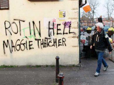 rot-in-hell-maggie-thatcher-graffiti-in-west-belfast-northern-ireland